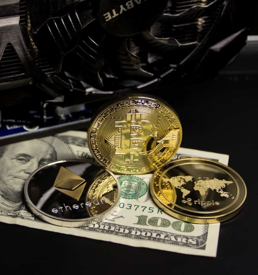 cryptocurrencies sitting on a dollar with a graphics card