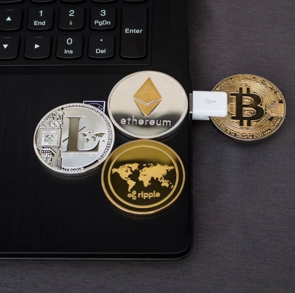a couple of altcoins on a laptop